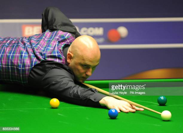 Mark King in action against Rory McLeod during the Betfredcom World Snooker Championship at The Crucible Theatre Sheffield