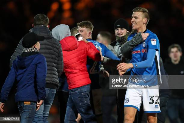 Mark Kitching of Rochdale celebrates with the fans at full time during The Emirates FA Cup Fourth Round Replay at Spotland Stadium on February 6 2018...