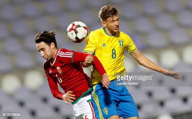 Mark Kleisz of Hungary U21 battles for the ball in the air with Anton Saletros of Sweden U21 during the UEFA Under 21 Euro 2019 Qualifier match...