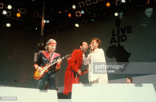 Mark Knopfler Jack Sonni and Sting at Live Aid Wembley sing the Dire straits song Money for Nothing on July 13 1985 in London United Kingdom 170612F1