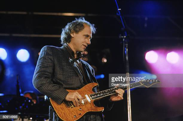 Mark Knopfler lead singer of Dire Straits performs at the Nelson Mandela concert at Wembley 13th June 1988