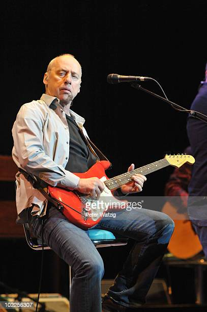 Mark Knopfler performs on stage at the LanxessArena on June 20 2010 in Cologne Germany