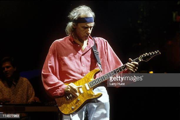 Mark Knopfler playing with Dire Straits ' performing at Oakland Coliseum in Oakland California on February 1 1992