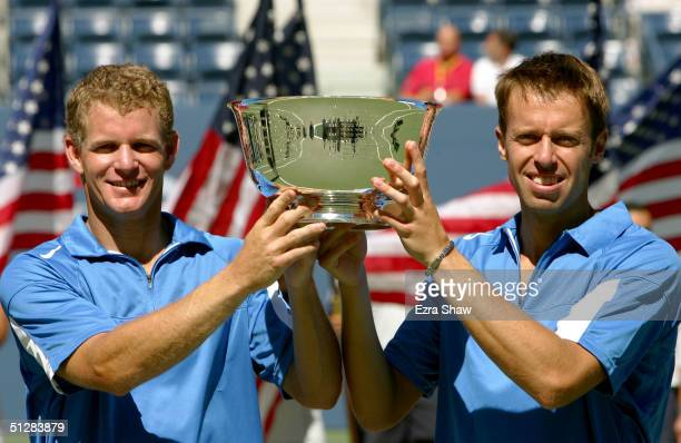 Mark Knowles and Daniel Nestor hold up the trophy after defeating Leander Paes and David Rikl and winning the men's double final during the US Open...