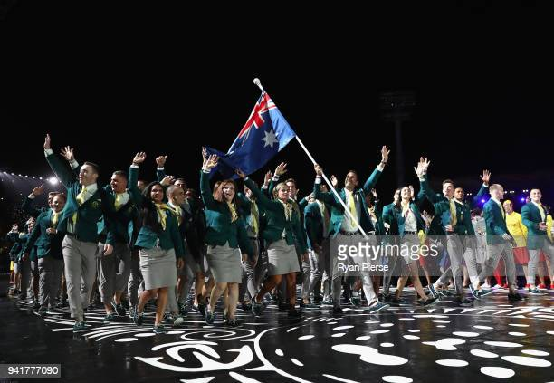 Mark Knowles, flag bearer of Australia arrives with the Australia team during the Opening Ceremony for the Gold Coast 2018 Commonwealth Games at...