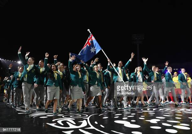 Mark Knowles flag bearer of Australia arrives with the Australia team during the Opening Ceremony for the Gold Coast 2018 Commonwealth Games at...