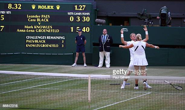 Mark Knowles of Bahamas and AnnaLena Groenefeld of Germany celebrate victory during the mixed doubles final match against Leander Paes of India plays...