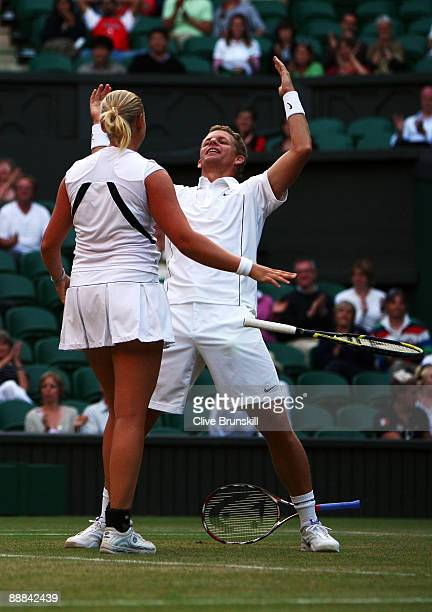 Mark Knowles of Bahamas and Anna-Lena Groenefeld of Germany celebrate victory during the mixed doubles final match against Leander Paes of India...