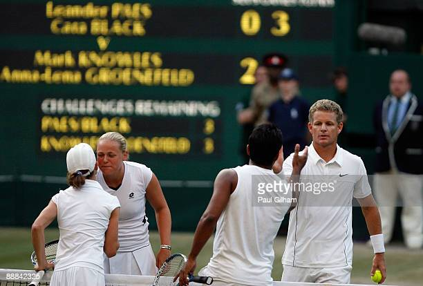 Mark Knowles of Bahamas and AnnaLena Groenefeld of Germany shake hands with runners up Leander Paes of India and Cara Black of Zimbabwe after the...