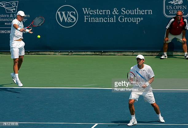 Mark Knowles of the Bahamas and Daniel Nestor of Canada return a shot in their doubles match with Mariusz Fyrstenberg of Poland and Marcin...