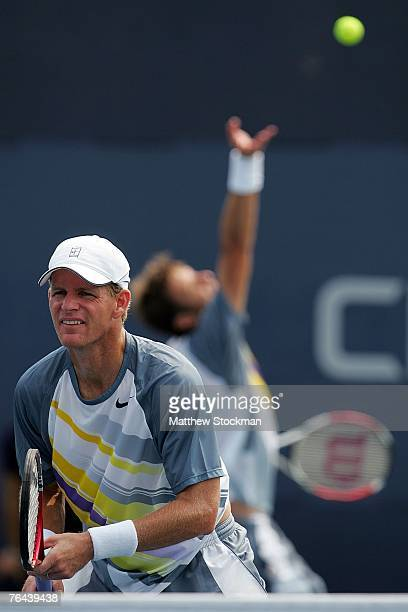 Mark Knowles of the Bahamas looks on as he and Daniel Nestor of Canada serves against Yves Allegro of Switzerland and Kristof Vliegen of Belgium...