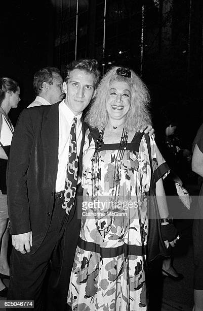Mark Kostabi and Sylvia Miles pose for a photo at a party for the premiere of David Lynch's film Wild at Heart on August 9th 1990 in New York City...