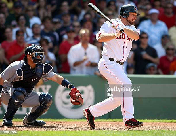 Mark Kotsay of the Boston Red Sox hits a 2 RBI single as Kenji Johjima of the Seattle Mariners defends on July 5 2009 at Fenway Park in Boston...