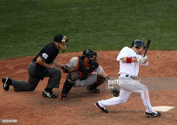 Mark Kotsay of the Boston Red Sox hits a 2 RBI triple in the eighth inning as Guillermo Quiroz of the Baltimore Orioles defends on September 3 2008...