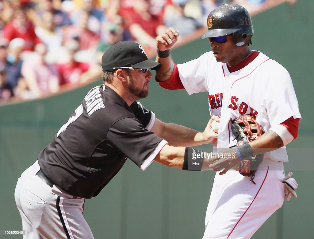 Mark Kotsay #7 of the Chicago White Sox tags out Darnell McDonald #54 of the Boston Red Sox as he tries to steal second base in the first inning on September 5, 2010 at Fenway Park in Boston, Massachusetts.