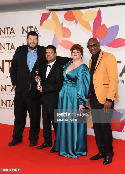 Mark Labbett Paul Sinha Jenny Ryan and Shaun Wallace accepting the Quiz Show award for The Chase pose in the Winners Room during the National...