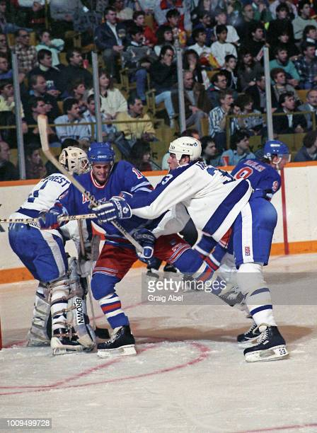 Mark Laforest and Al Iafrate of the Toronto Maple Leafs skate against Tony Granato of the New York Rangers skates against the Toronto Maple Leafs...