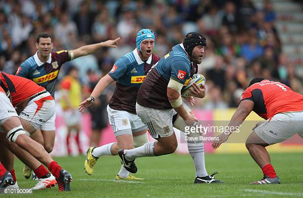 Mark Lambert of Harlequins runs with the ball during the Aviva Premiership match between Harlequins and Saracens at Twickenham Stoop on September 24...