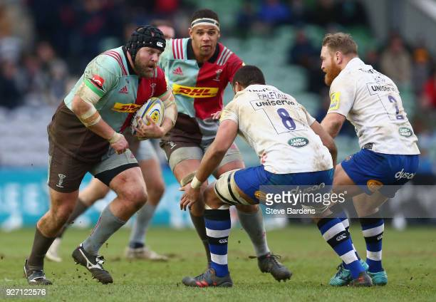 Mark Lambert of Harlequins takes on Taulupe Faletau of Bath Rugby during the Aviva Premiership match between Harlequins and Bath Rugby at Twickenham...