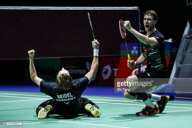 Mark Lamsfuss and Marvin Seidel of Germany celebrate the victory in the Men's Doubles second round match against Hiroyuki Endo and Yuta Watanabe of...