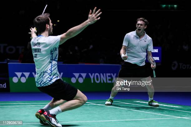 Mark Lamsfuss and Marvin Seidel of Germany celebrate the victory after the Men's Doubles second round match against Tan Qiang and He Jiting of China...