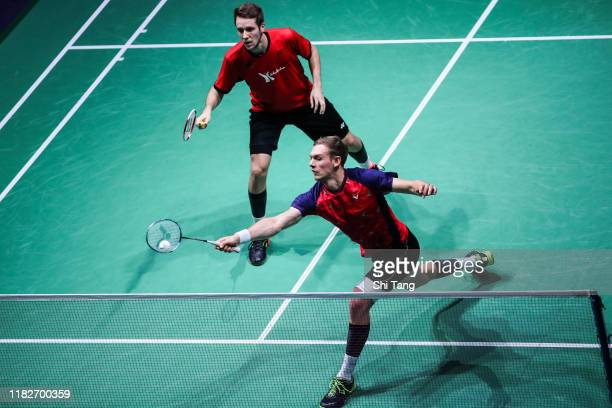 Mark Lamsfuss and Marvin Seidel of Germany compete in the Men's Doubles first round match against Han Chengkai and Zhou Haodong of China on day one...