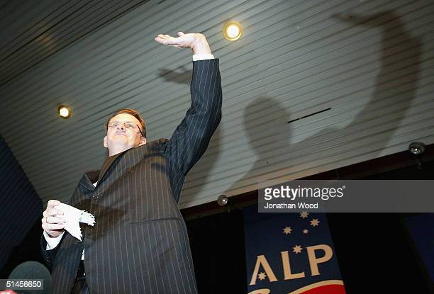 Mark Latham Federal Leader of the Australian Labor Party waves to supporters as he leaves the stage after conceding defeat in the Federal election at...