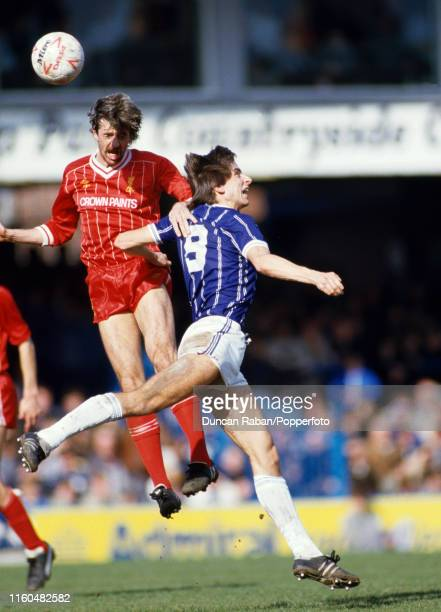 Mark Lawrenson of Liverpool and Alan Smith of Leicester City compete in the air for the ball during a Canon League Division One match at Filbert...