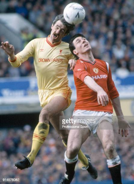 Mark Lawrenson of Liverpool heads the ball away from Frank Stapleton of Manchester United during the FA Cup Semi Final at Goodison Park on April 13...
