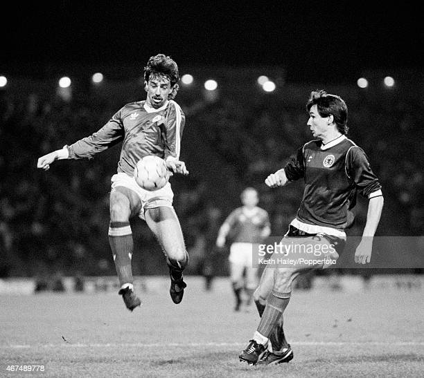 Mark Lawrenson of the Republic of Ireland in action against his Liverpool teammate Alan Hansen of Scotland during their European Championship...