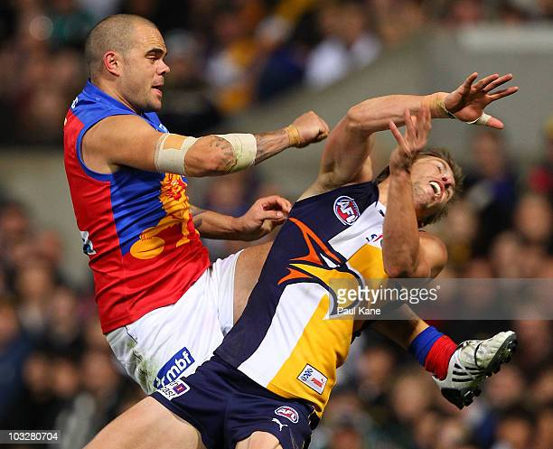 Mark LeCras of the Eagles and Ashley McGrath of the Lions contest a mark during the round 19 AFL match between the West Coast Eagles and the Brisbane...