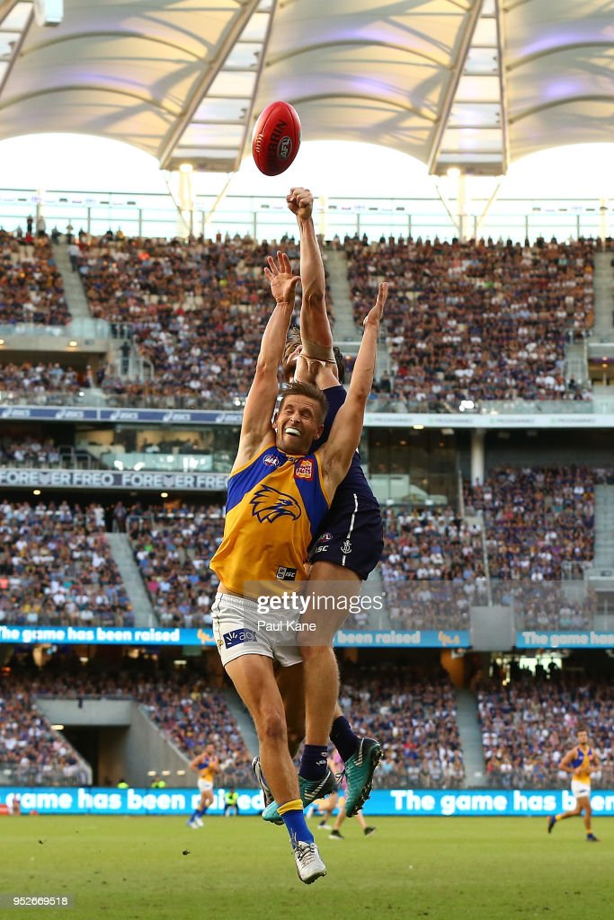 Mark LeCras of the Eagles and Connor Blakely of the Dockers contest a mark during the Round 6 AFL match between the Fremantle Dockers and West Coast Eagles at Optus Stadium on April 29, 2018 in Perth, Australia.