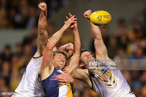 Mark LeCras of the Eagles and Matthew Suckling and Sam Mitchell of the Hawks go for the ball during the AFL Qualifying Final match between the West...