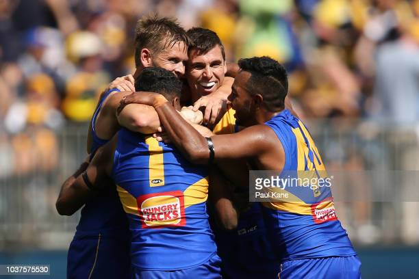 Mark LeCras of the Eagles celebrates a goal with Jamie Cripps Liam Ryan and Willie Rioli during the AFL Preliminary Final match between the West...