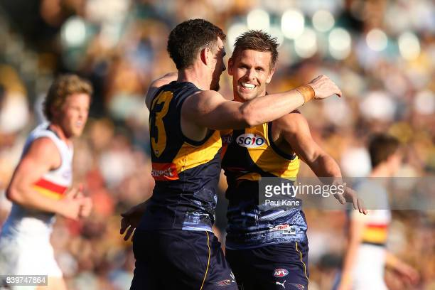 Mark LeCras of the Eagles celebrates a goal with Luke Shuey during the round 23 AFL match between the West Coast Eagles and the Adelaide Crows at...