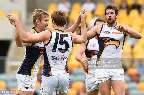 Mark LeCras of the Eagles celebrates kicking a goal with team mates during the round 13 AFL match between the Brisbane Lions and the West Coast...