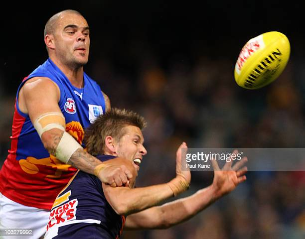 Mark LeCras of the Eagles has his mark spoilt by Ashley McGrath of the Lions during the round 19 AFL match between the West Coast Eagles and the...