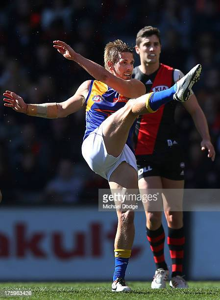 Mark LeCras of the Eagles kicks the ball during the round 20 AFL match between the Essendon Bombers and the West Coast Eagles at Etihad Stadium on...