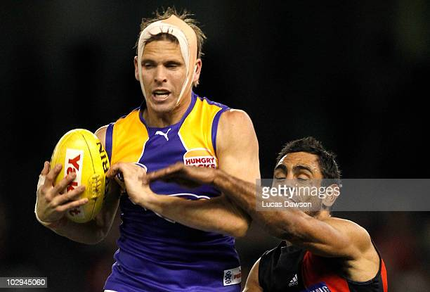 Mark Lecras of the Eagles marks the ball during the round 16 AFL match between the Essendon Bombers and the West Coast Eagles at Etihad Stadium on...