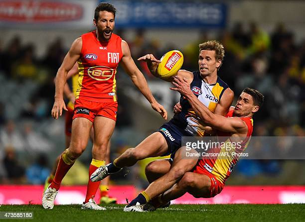 Mark LeCras of the West Coast Eagles is tackled by Dion Prestia of the Gold Coast Suns during the round seven AFL match between the West Coast Eagles...