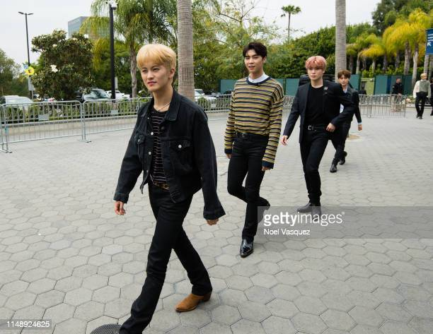 Mark Lee Johnny and Jaehyun of NCT 127 visit Extraat Universal Studios Hollywood on May 13 2019 in Universal City California
