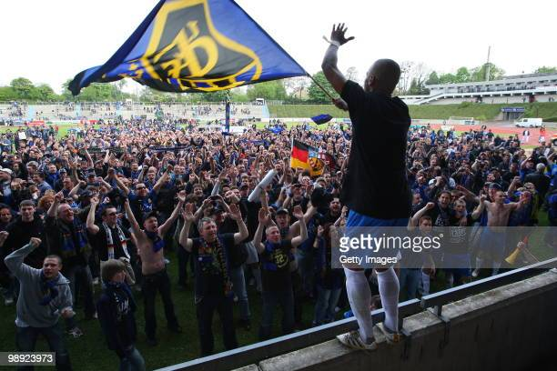 Mark Lerandy of Saarbruecken celebrates with fans after the Regionalliga match between Bonner SC and 1.FC Saarbruecken at the ARENA stadium on May 8,...