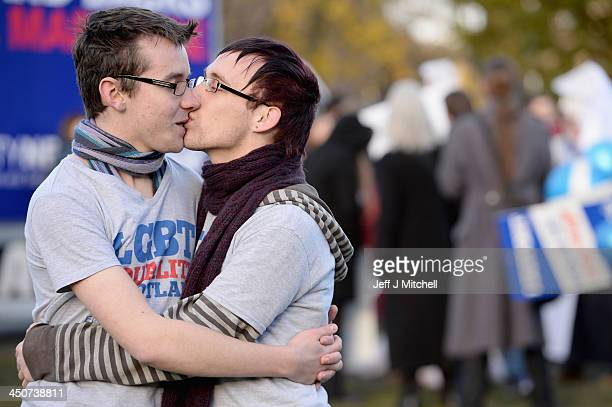 Mark Lerra and Connor Finlayson kiss as they join campaigners from the Equality Network holding a rally outside the Scottish Parliament on November...
