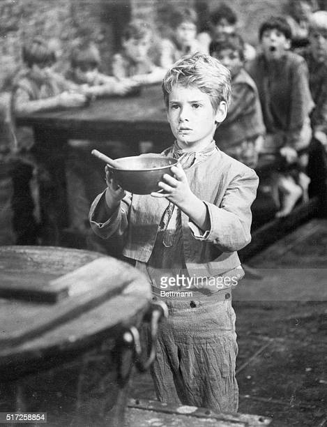 Mark Lester actor holding a bowl in a scene from the movie Oliver