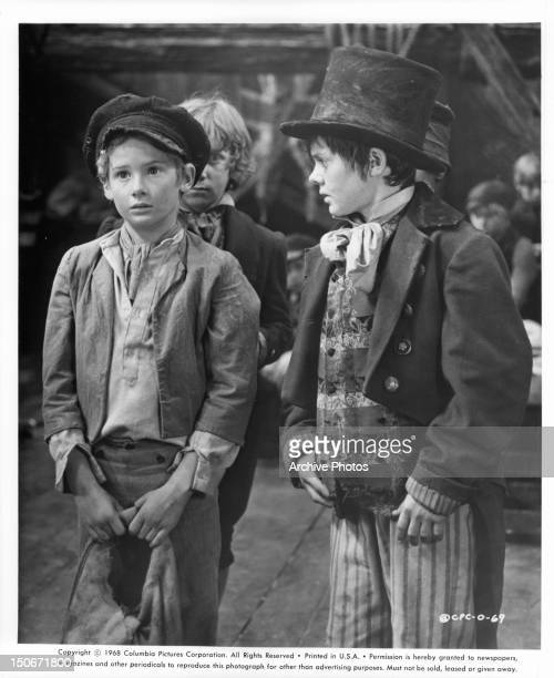Mark Lester and Jack Wild as Oliver and the Artful Dodger standing together in a scene from the film 'Oliver' 1968