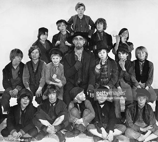 Mark Lester as Oliver Twist Ron Moody as Fagin and Jack Wild as The Artful Dodger are surrounded by the orphan boys trained as pick pockets by Fagin...