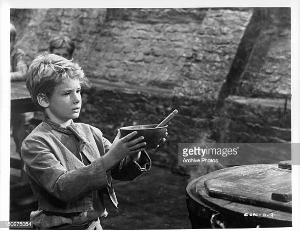 Mark Lester, playing Oliver, holding empty bowl in a scene from the film 'Oliver!', 1968.