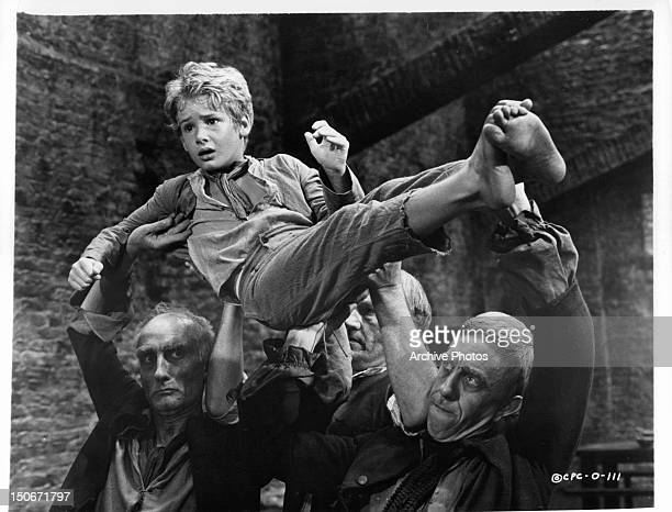 Mark Lester, playing Oliver, is carried away in a scene from the film 'Oliver!', 1968.