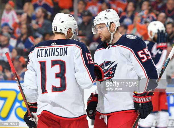 Mark Letestu and Cam Atkinson of the Columbus Blue Jackets discuss the play during the game against the Edmonton Oilers on March 27 2018 at Rogers...