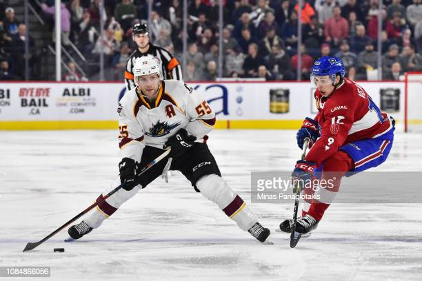 Mark Letestu of the Cleveland Monsters looks to play the puck near Lukas Vejdemo of the Laval Rocket during the AHL game at Place Bell on January 18,...